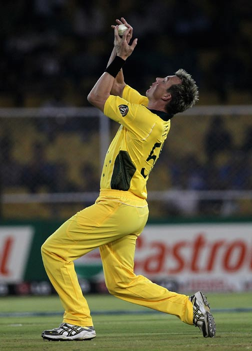 Brett Lee takes a catch of his own bowling to dismiss Charles Coventry during the 2011 ICC World Cup Group A match between Australia and Zimbabwe at Sardar Patel Stadium in Ahmedabad. (Getty Images)