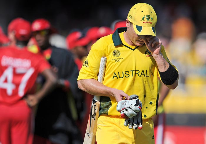 Brad Haddin walks off the grounds after being dismissed by Zimbabwe during their World Cup match at the Sardar Patel Gujarat Stadium in Ahmedabad. (AFP Photo)