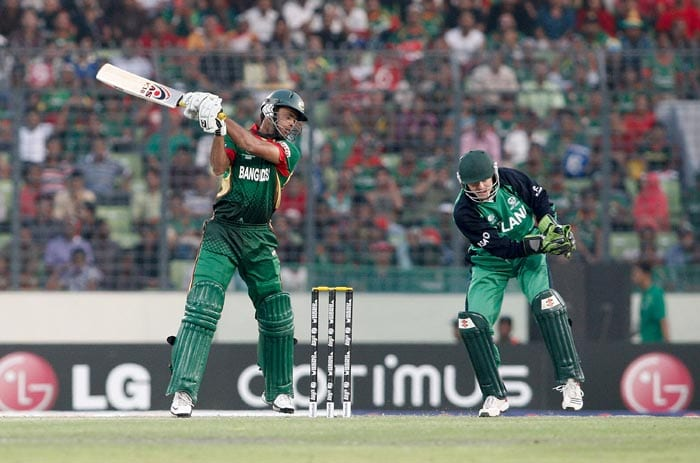 Abdur Razzak bats during the 2011 ICC World Cup Group B match between Bangladesh and Ireland at Sher-e-Bangla National Stadium in Dhaka. (Getty Images)