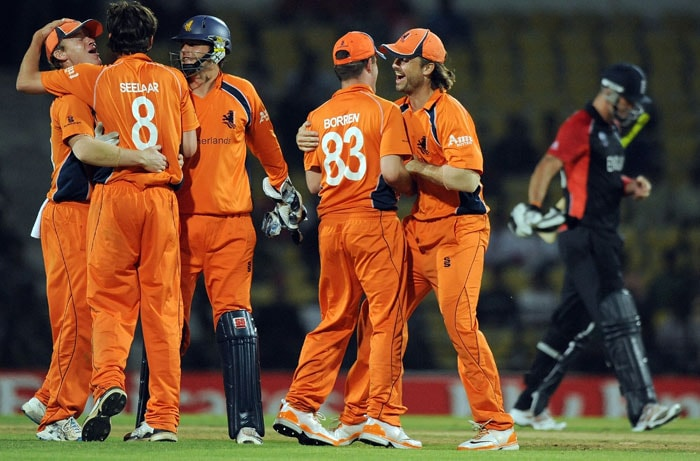 Netherlands cricketers celebrate the dismissal of Kevin Pietersen during the ICC Cricket World Cup 2011 match between England and The Netherlands at the Vidarbha Cricket Association Stadium. (AFP Photo)