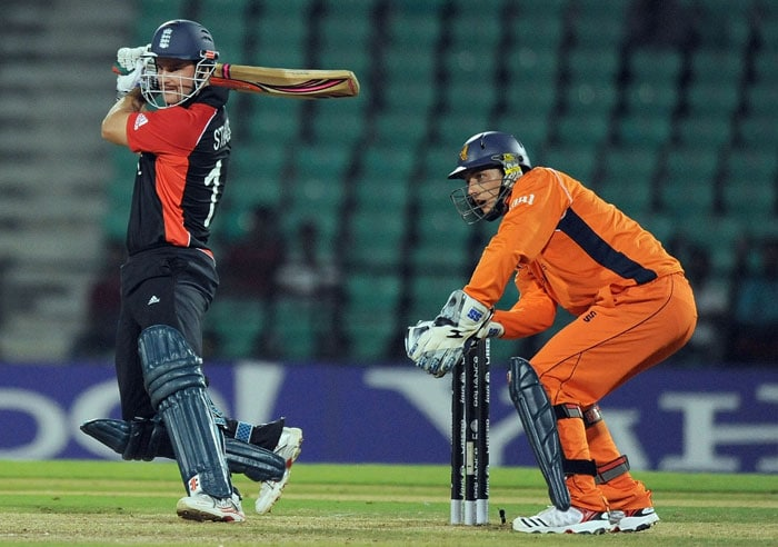 Andrew Strauss watched by Netherlands cricketer Wesley Barresi plays a shot during the ICC Cricket World Cup 2011 match between England and The Netherlands at the Vidarbha Cricket Association Stadium. (AFP Photo)