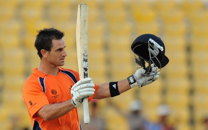 Ryan ten Doeschate celebrates his century during the ICC Cricket World Cup 2011 match between England and Netherlands at the Vidarbha Cricket Association Stadium. (AFP Photo)