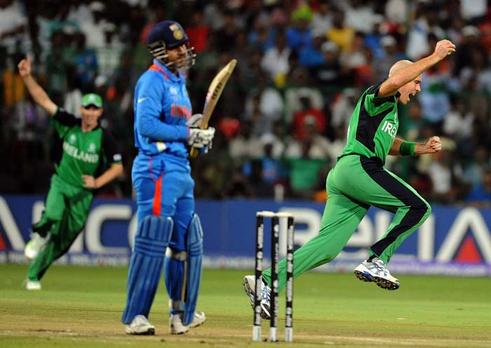 Trent Johnston celebrates Virender Sehwag's wicket during the ICC World Cup 2011 match between India and Ireland at the M. Chinnaswamy Stadium in Bangalore. (AFP Photo)