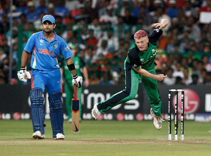 Kevin O'Brien bowling watched by Virat Kohli during the Group B match of the ICC World Cup between India and Ireland at M. Chinnaswamy Stadium in Bangalore. (Getty Images)