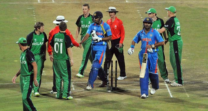 Ireland cricketers congratulate India cricketers Yusuf Pathan and Yuvraj Singh after India won the Group B match of the the ICC World Cup at the M. Chinnaswamy Stadium in Bangalore. India won the match by 5 wickets. (AFP Photo)