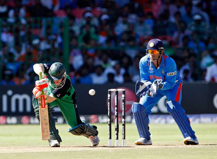 Niall O'Brien defends while MS Dhoni looks on during the the Group B - 2011 ICC World Cup match between India and Ireland at M. Chinnaswamy Stadium in Bangalore. (Getty Images)