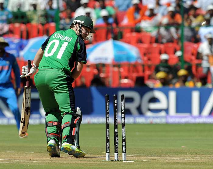 Paul Stirling watches his bails fly into the air after being clean bowled by Zaheer Khan during the ICC World Cup match between India and Ireland at the M. Chinnaswamy Stadium in Bangalore. (AFP Photo)