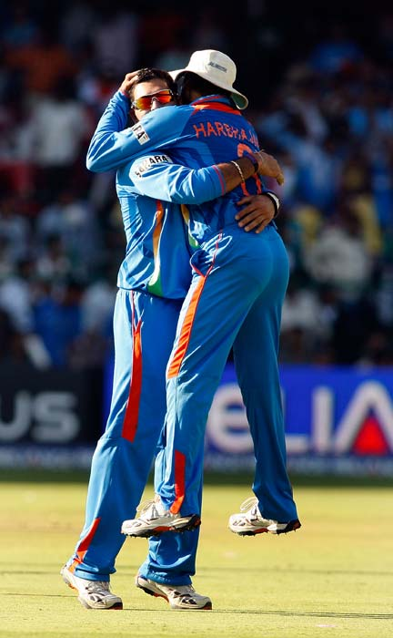 Yuvraj Singh and Harbhajan Singh celebrate after Yuvraj caught and bowled Kevin O'Brien for 9 during the Group B World Cup match between India and Ireland at M. Chinnaswamy Stadium in Bangalore, India. (Getty Images)