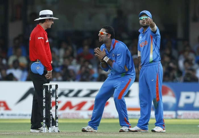 Yuvraj Singh gestures to the umpire while waiting for a review decision against Alex Cusack during the Group B World Cup match between India and Ireland at M. Chinnaswamy Stadium in Bangalore, India. (AP Photo)