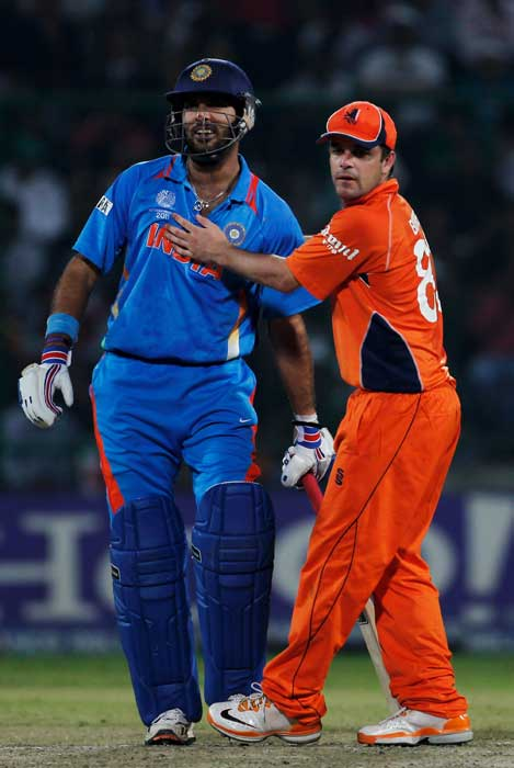 Peter Borren apologises to Yuvraj Singh after hitting him with a throw at the stumps during the 2011 ICC Cricket World Cup Group B match between India and the Netherlands at Feroz Shah Kotla stadium in New Delhi. (Getty Images)