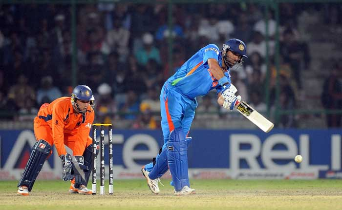 Wesley Barresi watches as Yuvraj Singh plays a shot during the ICC World Cup match between India and the Netherlands at the Feroz Shah Kotla Stadium in New Delhi. (AFP Photo)