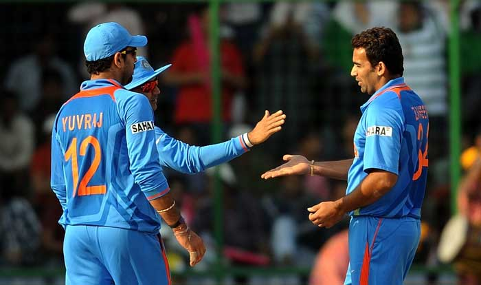 Zaheer Khan the wicket of Bas Zuiderent with Yuvraj Singh and Virender Sehwag during the ICC World Cup match between India and Netherlands at the Feroz Shah Kotla Stadium in New Delhi. (AFP Photo)