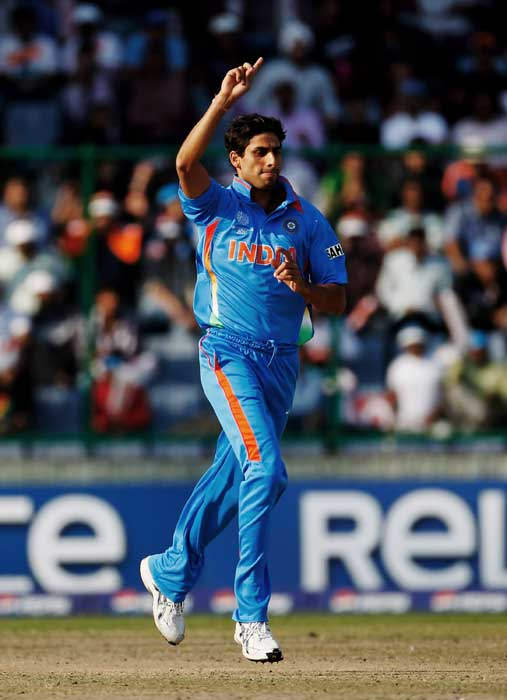 Ashish Nehra celebrates after taking the wicket of Tom Cooper during the ICC Cricket World Cup Group B match between India and the Netherlands at Feroz Shah Kotla Stadium. (Getty Images)