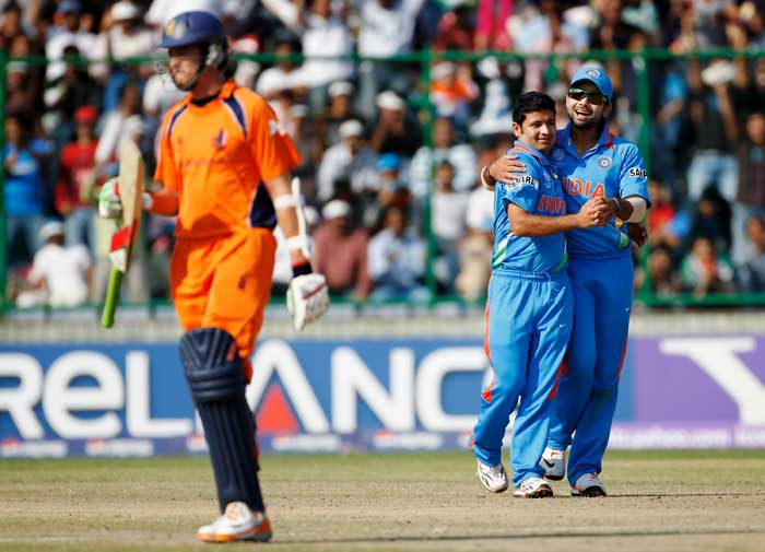 Piyush Chawla celebrates with teammate Virat Kohli after taking the wicket of Eric Szwarczynski during the ICC Cricket World Cup Group B match between India and the Netherlands at Feroz Shah Kotla Stadium in New Delhi. (Getty Images)