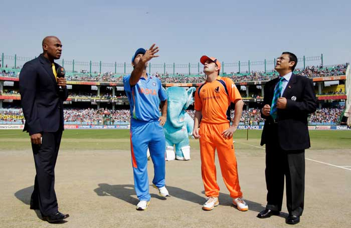 Indian captain MS Dhoni takes the coin toss, watched by Netherlands captain Peter Borren before the start of the 2011 ICC Cricket World Cup Group B match between India and the Netherlands at Feroz Shah Kotla Stadium in New Delhi. (Getty Images)