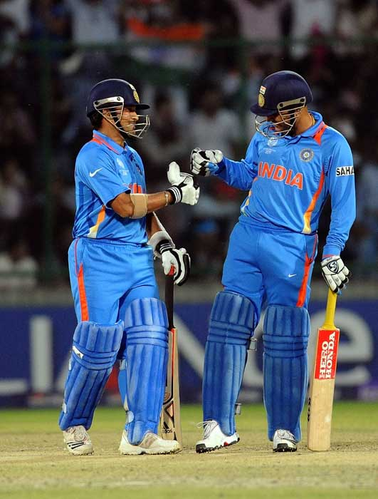 Virender Sehwag congratulates Sachin Tendulkar after a boundary during the ICC World Cup match between India and the Netherlands at the Feroz Shah Kotla Stadium in New Delhi. (AFP Photo)