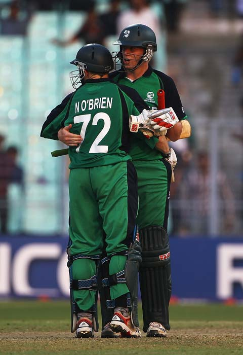Niall O'Brien celebrates his team's win with his brother Kevin O'Brien during the 2011 ICC World Cup match between Ireland and The Netherlands at the Eden Gardens in Kolkata. (Getty Images)