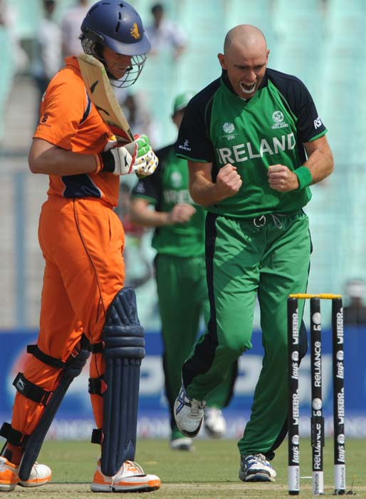 Trent Johnston celebrates the dismissal of Eric Swarczynski watched by Wesley Baressi during the Group B match 38 between The Netherlands and Ireland in the World Cup 2011 tournament at the Eden Gardens in Kolkata. (AFP Photo)