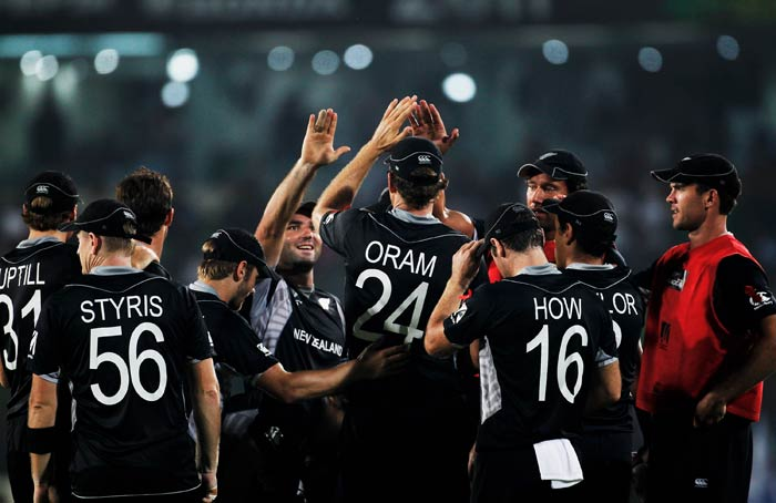 Jacob Oram celebrates with teammates after taking a catch on the boundary to dismiss Jacques Kallis off the bowling of Tim Southee during the 2011 ICC World Cup quarter final match between New Zealand and South Africa at the Sher-e-Bangla National Stadium in Dhaka. (Getty Images)