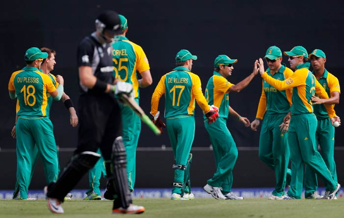 Johan Botha celebrates with teammates after taking the catch to dismiss of Martin Guptill off the bowling of Robin Peterson during the 2011 ICC World Cup quarter final match between New Zealand and South Africa at the Sher-e-Bangla National Stadium in Dhaka. (Getty Images)