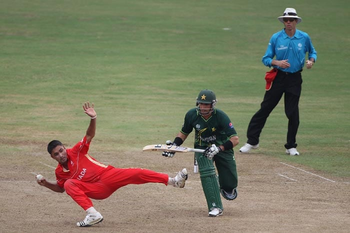 Harvir Baidwan gathers the ball and aims to run out Misbah-ul-Haq as Umar Akmal backs up during the Canada vs Pakistan 2011 ICC World Cup Group A match at the R. Premadasa Stadium in Colombo. (Getty Images)
