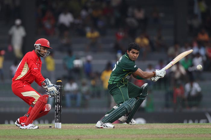 Umar Akmal plays to the off-side as wicketkeeper Ashish Bagai looks on during the Canada vs Pakistan 2011 ICC World Cup Group A match at the R. Premadasa Stadium in Colombo. (Getty Images)