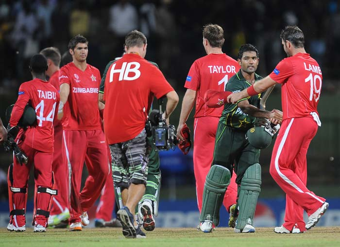 Gregory Lamb is congratulated by Asad Shafiq after victory in the Group A match in the World Cup tournament between Pakistan and Zimbabwe at the Pallekele International Cricket Stadium in Pallekele. Pakistan qualified for the World Cup quarter-finals on Monday with a seven-wicket win over Zimbabwe in a Group A match. (AFP Photo)