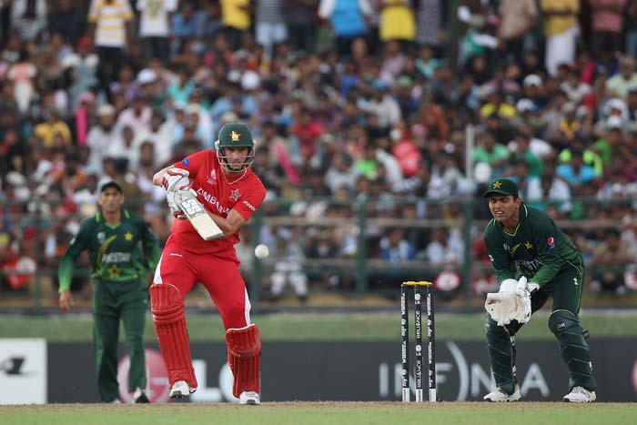 Craig Ervine plays to the offside as wicketkeeper Kamran Akmal looks on during the Pakistan v Zimbabwe 2011 ICC World Cup Group A match at the Pallekele Cricket Stadium in Kandy. (Getty Images)