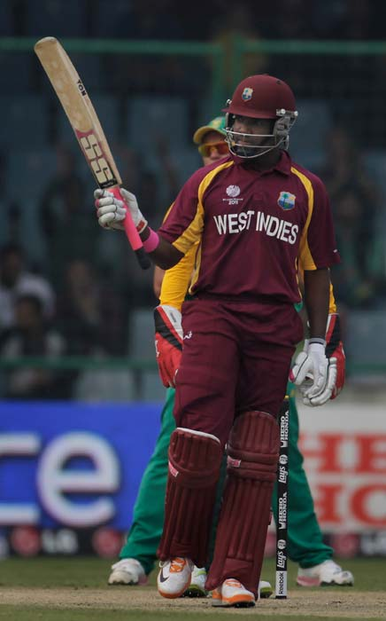 Darren Bravo raises his bat on scoring his half-century during the 2011 ICC World Cup Group B match between West Indies and South Africa at Feroz Shah Kotla Stadium in New Delhi. (Getty Images)