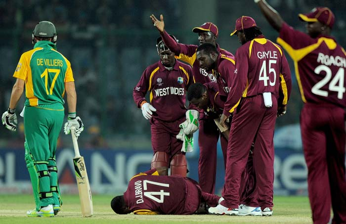 Dwayne Bravo lies on the ground after being injured during their match against South Africa at the Feroz Shah Kotla stadium in New Delhi. (AFP Photo)