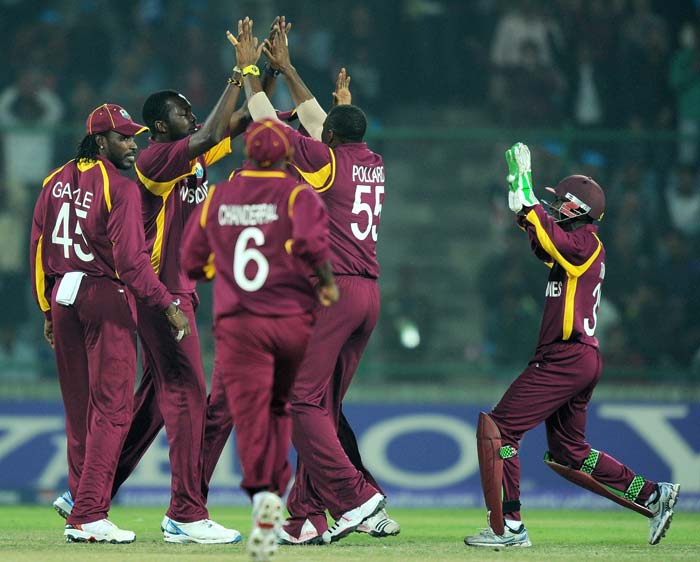 Kieron Pollard celebrates with teammates after taking the wicket of Jacques Kallis during their match at the Feroz Shah Kotla stadium in New Delhi. (AFP Photo)