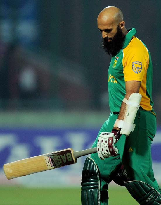 Hashim Amla walks back to the pavilion after his dismissal during their match at the Feroz Shah Kotla stadium in New Delhi. (AFP Photo)