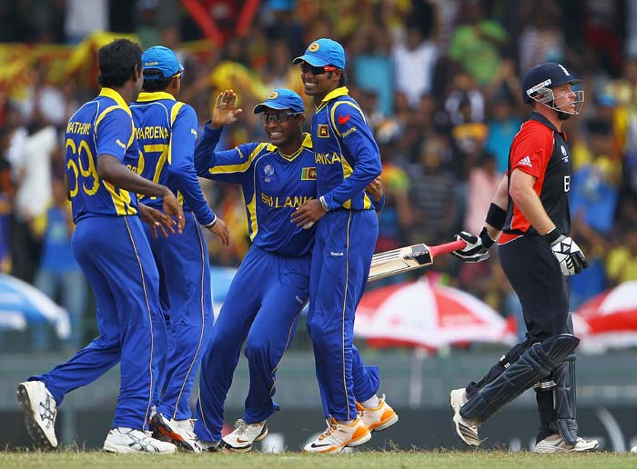 Thilan Samaraweera is congratulated by teammates after he caught Ian Bell off the bowling of Angelo Mathews during the 2011 ICC World Cup quarter final match between Sri Lanka and England at the R. Premadasa Stadium in Colombo. (Getty Images)