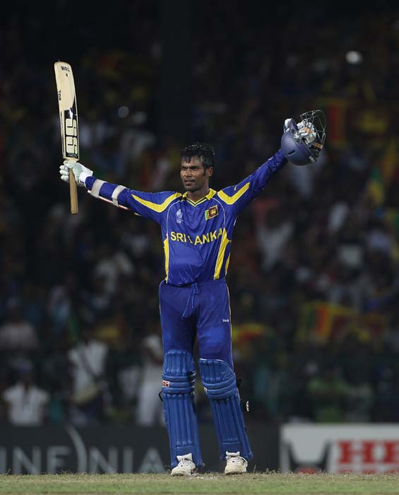 Upul Tharanga celebrates reaching his century and hitting the winning runs during the 2011 ICC World Cup quarter final match between Sri Lanka and England at the R. Premadasa Stadium in Colombo. (Getty Images)