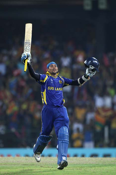 Tillakaratne Dilshan celebrates reaching his century during the 2011 ICC World Cup quarter final match between Sri Lanka and England at the R. Premadasa Stadium in Colombo. (Getty Images)