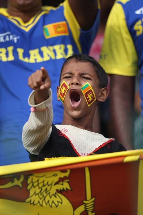 A young Sri Lanka fan cheers on his country during the 2011 ICC World Cup quarter final match between Sri Lanka and England at the R. Premadasa Stadium in Colombo. (Getty Images)