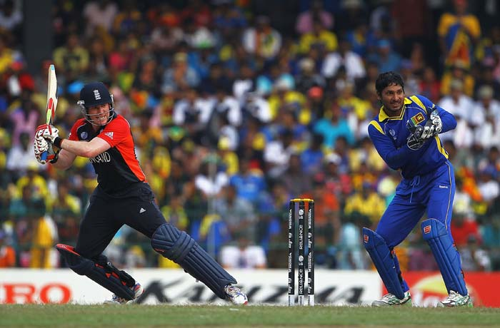 Eoin Morgan hits the ball towards the boundary as Kumar Sangakkara looks on during the 2011 ICC World Cup quarter final match between Sri Lanka and England at the R. Premadasa Stadium in Colombo. (Getty Images)