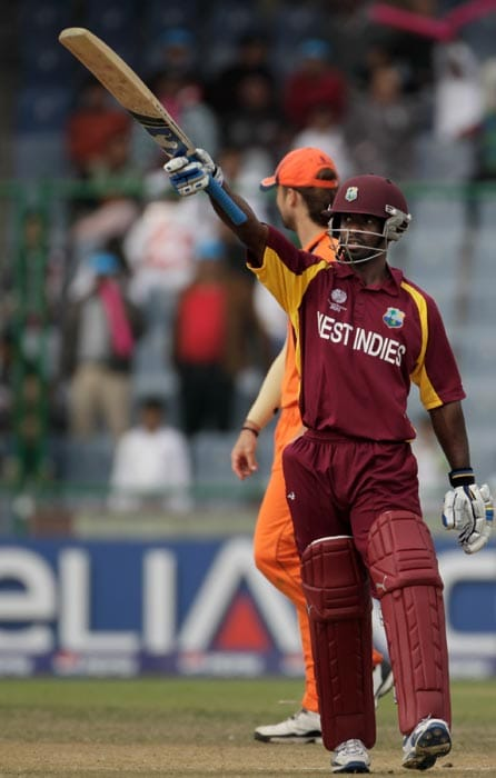 Devon Smith raises his bat on scoring his half-century during the 2011 ICC World Cup group B match between Netherlands and West Indies at Feroz Shah Kotla stadium in New Delhi. (Getty Images)
