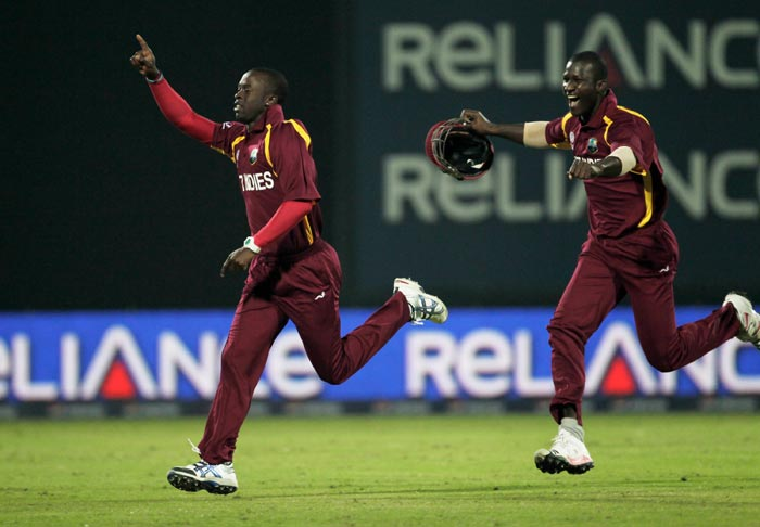 Kemar Roach celebrates his hat-trick and winning the game with captain Darren Sammy during the 2011 ICC World Cup group B match between Netherlands and West Indies at Feroz Shah Kotla stadium in New Delhi. (Getty Images)
