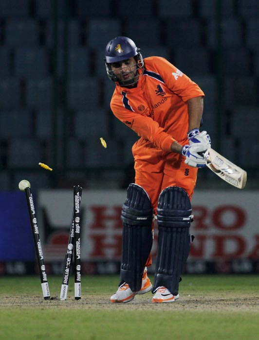Mudassar Bukhari is bowled by Kemar Roach during the 2011 ICC World Cup group B match between Netherlands and West Indies at Feroz Shah Kotla stadium in New Delhi. (Getty Images)