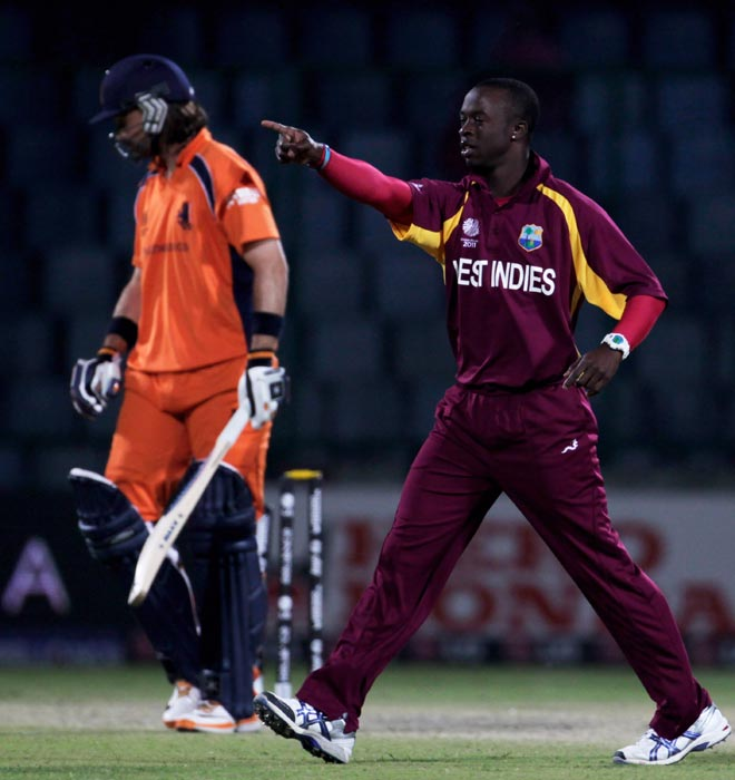 Kemar Roach celebrates the wicket of Bas Zuiderent during the 2011 ICC World Cup group B match between Netherlands and West Indies at Feroz Shah Kotla stadium in New Delhi. (Getty Images)