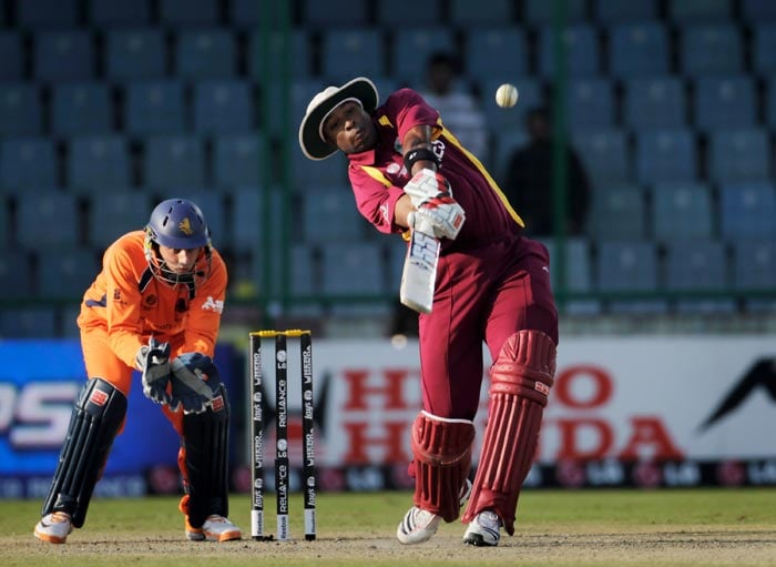 Kieron Pollard hits six during the 2011 ICC World Cup group B match between Netherlands and West Indies at Feroz Shah Kotla stadium in New Delhi. (Getty Images)