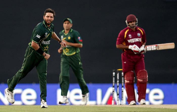 Shahid Afridi celebrates the wicket of Ravi Rampaul during the first ICC 2011 World Cup quarter-final at Shere-e-Bangla National Stadium in Dhaka. (Getty Images)