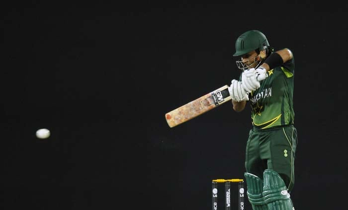 Kamran Akmal plays a square drive for a four during the ICC World Cup quarter-final match between Pakistan and West Indies in Dhaka. (AP Photo)