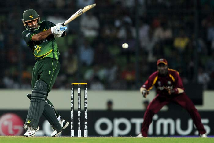 Mohammad Hafeez is watched by a West Indies fielder as he plays a shot during the ICC World Cup 2011 quarter-final between West Indies and Pakistan at the Sher-e Bangla National Stadium in Dhaka. (AFP Photo)