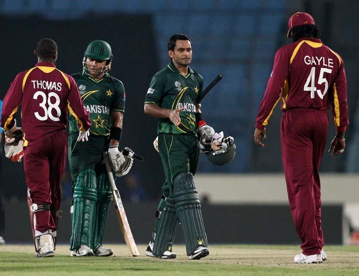 Mohammad Hafeez and Kamran Akmal shake hands with Devon Thomas and Chris Gayle of the West Indies after Pakistan's victory during the first ICC World Cup quarter-final at the Sher-e-Bangla National Stadium in Dhaka. (Getty Images)