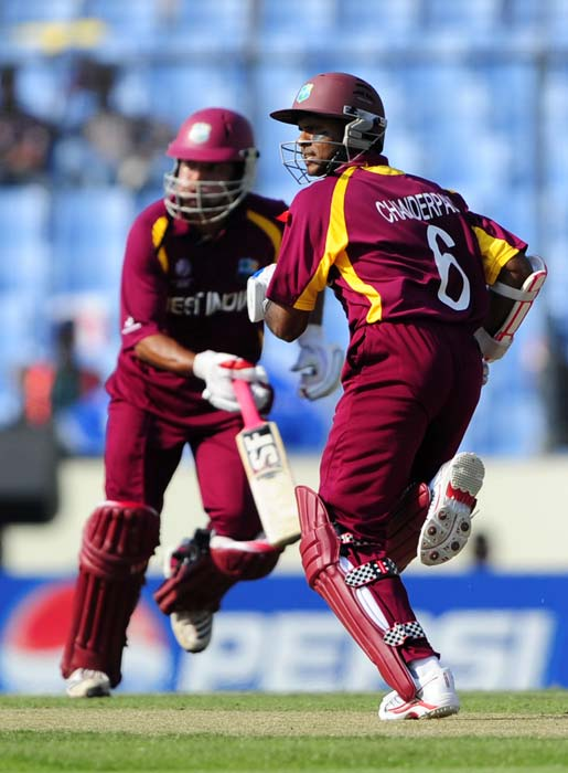 Shivnarine Chanderpaul and Ramnaresh Sarwan run between the wickets during the World Cup 2011 quarter-final match between West Indies and Pakistan at the Sher-e Bangla National Stadium in Dhaka. (AFP Photo)