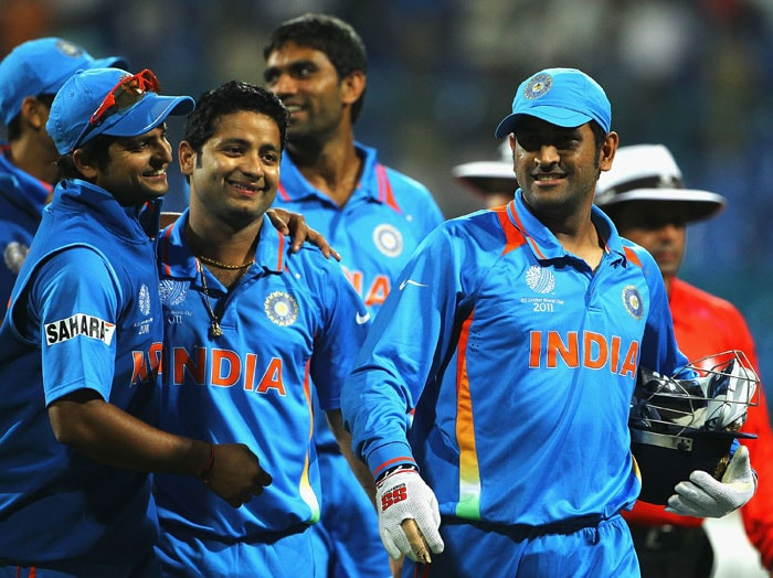 Indian captain MS Dhoni walks off with Suresh Raina and Piyush Chawla after beating Australia during the 2011 ICC World Cup warm-up game at the M. Chinnaswamy Stadium in Bangalore. (Getty Images)