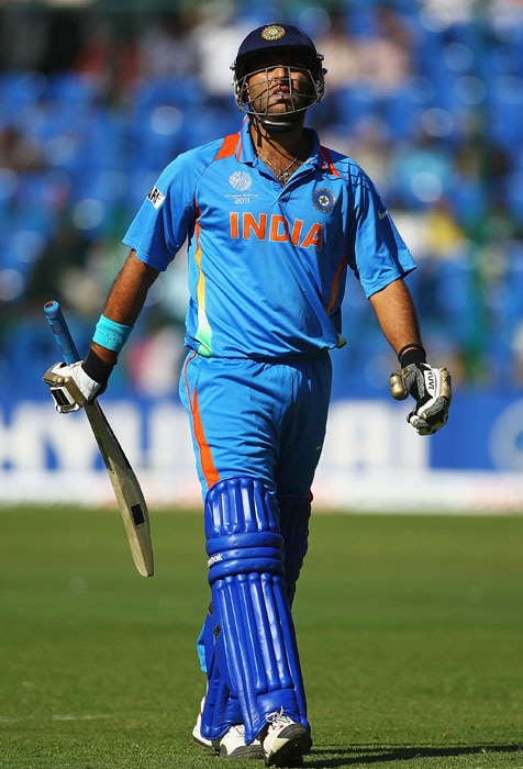 Yuvraj Singh walks off after being caught by Tim Paine off the bowling of Mitchell Johnson during the 2011 ICC World Cup warm-up game between India and Australia at the M. Chinnaswamy Stadium in Bangalore. (Getty Images)
