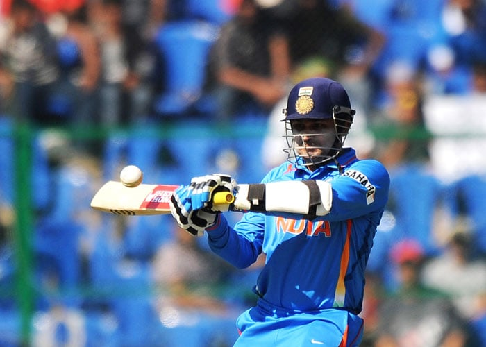 Virender Sehwag plays a shot during a warm-up match against Australia ahead of the 2011 World Cup at M.Chinnaswamy Stadium in Bangalore. (AFP Photo)